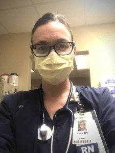 Selfie of Erica who is wearing nurse's scrubs and a mask